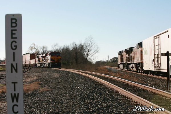 KCS and UP freight trains at Rosenberg, TX