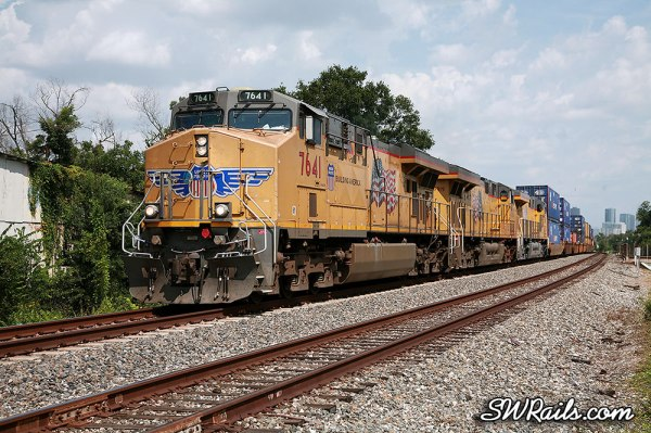 UP 7641 leads a ZATLC train across the I-10 overpass just west of downtown Houston, TX on August 11, 2012