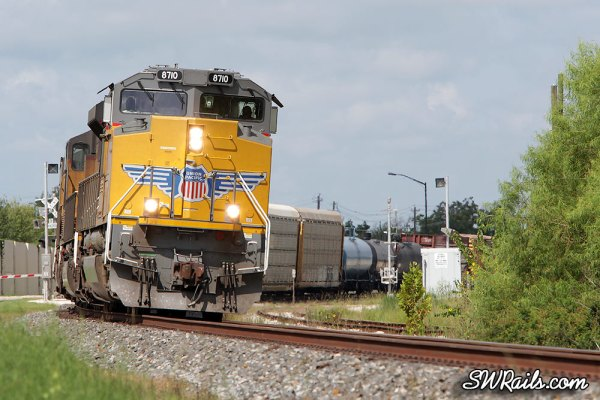 Union Pacific SD70ACe 8710 on QWCEW freight train at Missouri City TX