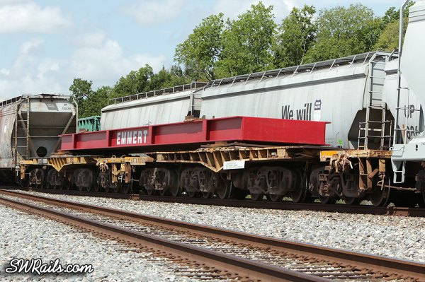 Emmert load on 2 12-axle QTTX flat cars