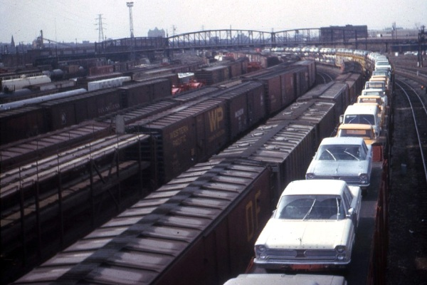 New Plymouth autos on railcars in St Louis in 1966