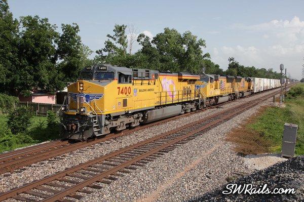 "UP 7400, the Komen ""pink ribbon"" unit leads ZLCAT train at Houston, TX"