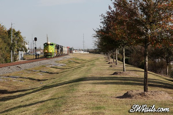 NS 1072 (Illinois terminal Heritage) leads UP freight train MEWEY-21 at Stafford, TX on 11/21/2012