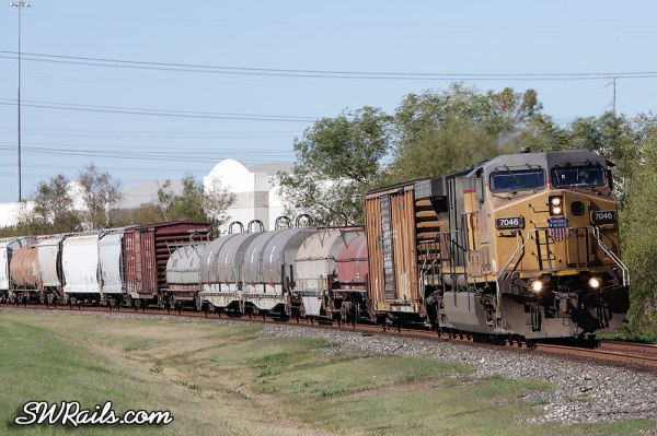 UP AC4400CW 7046 leading freight train MEGEW at Stafford TX