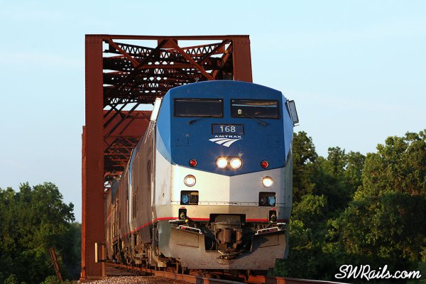 Amtrak P42DC 168 leads train #1 across the Brazos River at Richmond TX