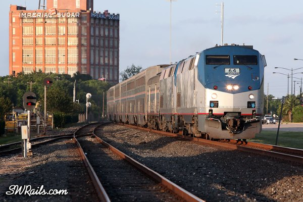 Amtrak P42 64 leads the Sunset Limited through Sugar Land, TX on 6/1/2013.