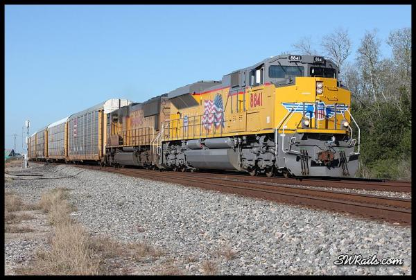 Union Pacific ILBEW led by brand-new SD70AH 8841 at West Junction TX on 3/18/2014