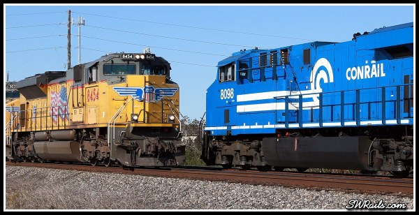 NS 8098, Conrail heritage locomotive,  and UP SD70ACE 8454 at Harlem, TX on 11-24-2014
