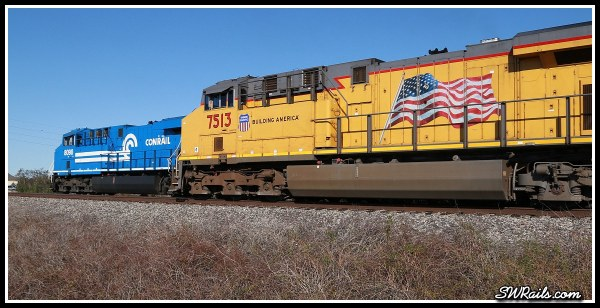 NS 8098, Conrail heritage locomotive,  and UP ES44AC 7513 at Harlem, TX on 11-24-2014