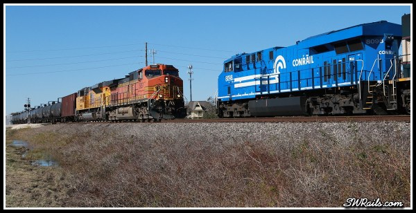 NS 8098, Conrail heritage locomotive,  and BNSF C44-9W 5057 at Harlem, TX on 11-24-2014